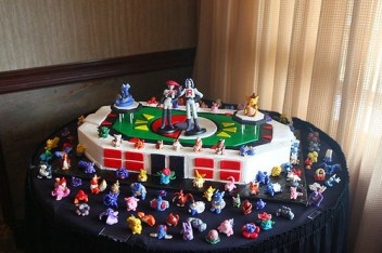 Epic Pokémon Stadium cake by kashii-tan. From the artist: People  were literally FIGHTING over getting their favorite pokemon with their  piece of cake but it was the most loved cake that everyone enjoyed. It  is modeled off of the Super Smash Bros. pokemon stadium and Jessie  (Musashi) and James (Kojiro) were the toppers Photography credit: Cassie S./Andrew K. | offbeatbride.ning.com/profile/Kashiitan  It's hard to tell from the angle of the pic, but it totally looks like they managed to squeeze all the original 151 'monz in there. And now to pressure my fiance into letting us get our own geeky wedding cake…