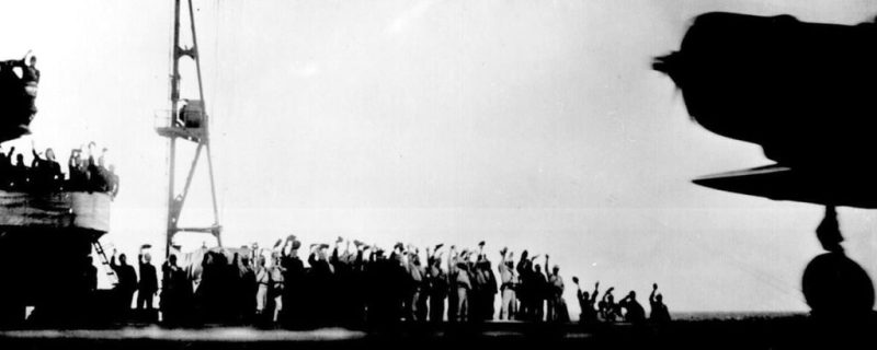 "In a Photograph taken aboard a Japanese carrier before the attack, A Nakajima B5N ""Kate"" torpedo bomber is cheered on by the carrier's crew. (National Archives)"