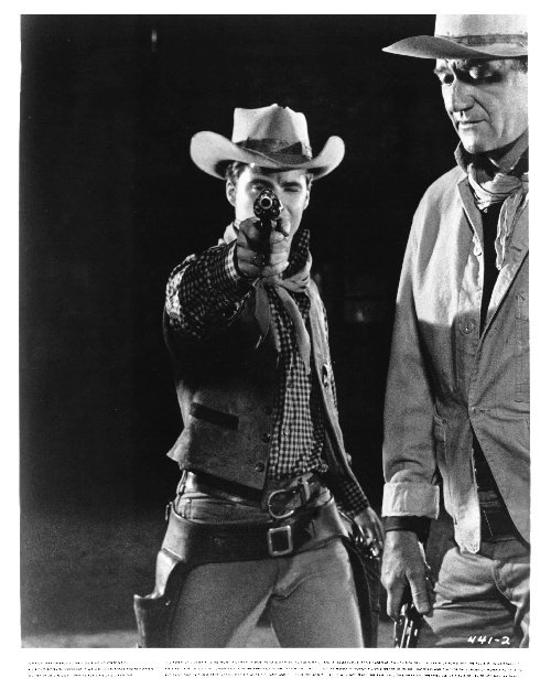 Ricky Nelson and John Wayne in a publicity still from Rio Bravo