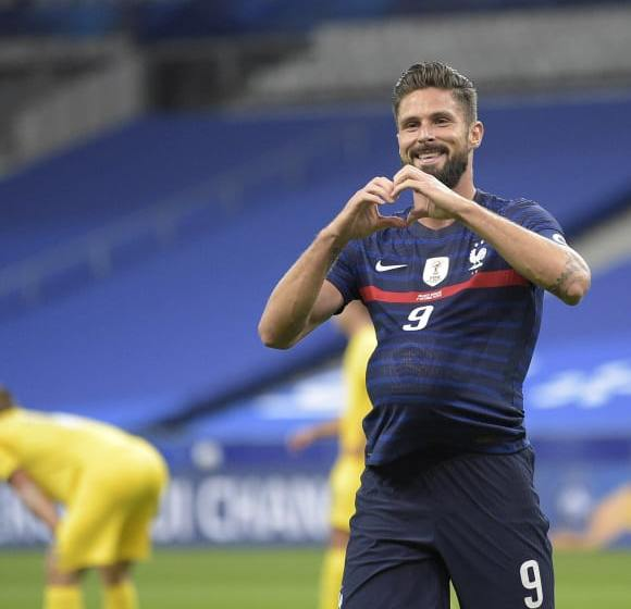 Giroud overtakes Platini as France trash Ukraine.