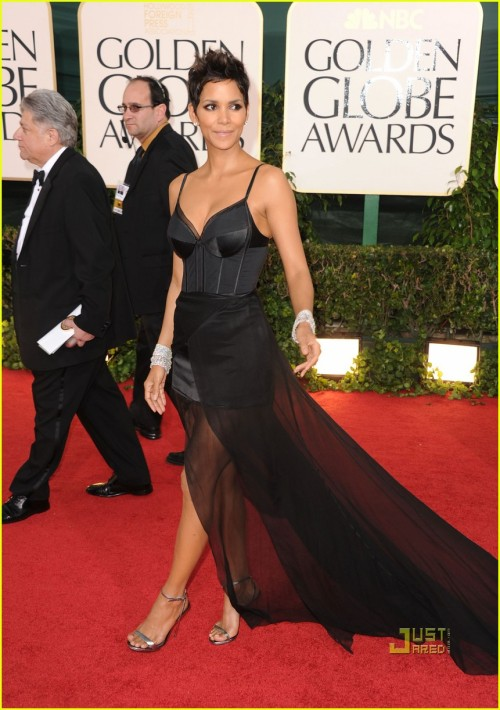 Halle Berry's glamor-dominatrix look fails. She looks like she put on her Betty Page costume, wrapped some tulle around it, and ran off.