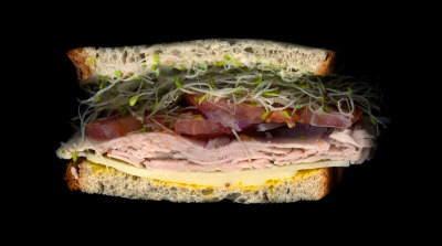Avenue B Grocery: Turkey, Provolone, Tomatoes, Sprouts, Onions, Mayo, Mustard, On Light Rye