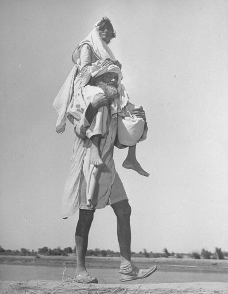 """1947: A Sikh man carrying his wife on his shoulders, migrating to Punjab after the partition of India. Photo by Margaret Bourke-White"" (from: happyindianfamilies.tumblr.com)"