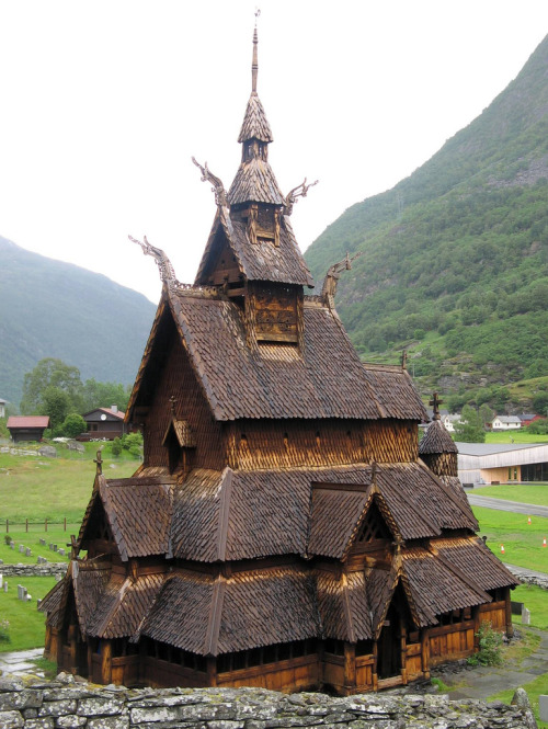Borgund Stave Church (Bokmål: Borgund stavkirke, Nynorsk: Borgund stavkyrkje) is a stave church located in Borgund, Lærdal,Norway. It is classified as a triple nave stave church of the so-called Sogn-type. This is also the best preserved of Norway's 28 extant stave churches. Borgund was built sometime between AD 1180 and 1250 with later additions and restorations. Its walls are formed by vertical wooden boards, or staves, hence the name stave church. The 4 corner posts were connected to one another by ground sills, resting atop a stone foundation.1 The rest of the staves then rise from the ground sills, each stave notched and grooved along the sides so that they lock into one another, forming a sturdy wall.2