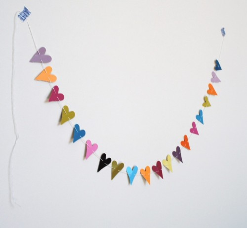 Heart Punch Paint Chip Bunting - An Easy Peasy Tutorial (via Tuesday Paper: DIY Paper Heart Garland | Sparkle & Hay Wedding Blog)