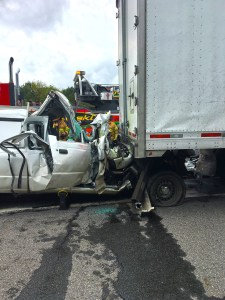Rescuers Free Driver from Mangled Vehicle