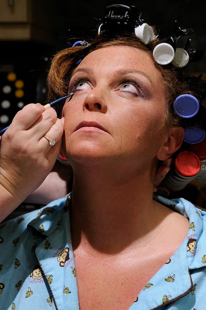 Applying lower eyeliner