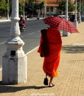 Monk walking on a street of Phnom Penh