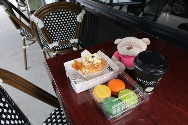 Orange dotted Muffin with delightful macarons and coffee from Marche du Macaron Brisbane - Total Damage of $27.5