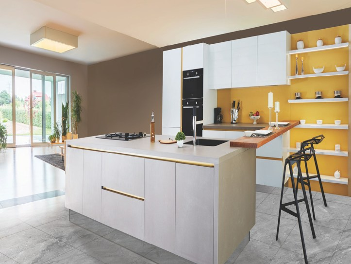Yellow wall in kitchen with shelving