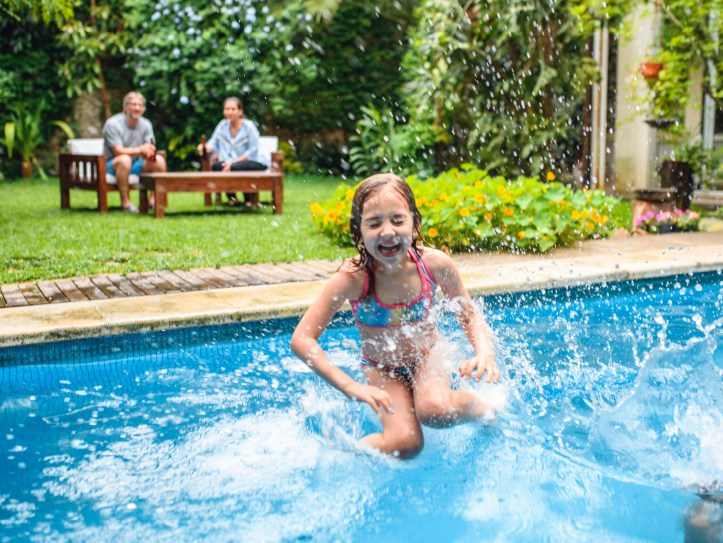 child jumping into a pool
