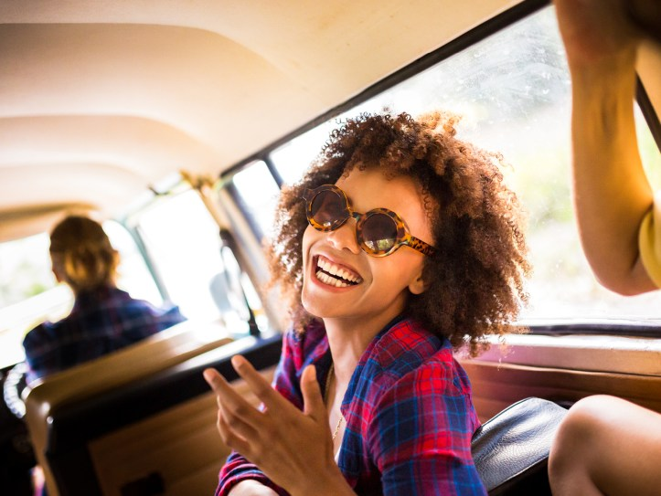 person smiling during RV roadtrip