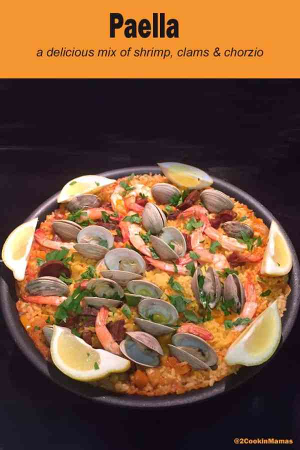 Paella | 2CookinMamas A traditional Spanish dish filled with clams, shrimp, chorizo on a bed of rice. A one pot dish ready in 30 minutes.