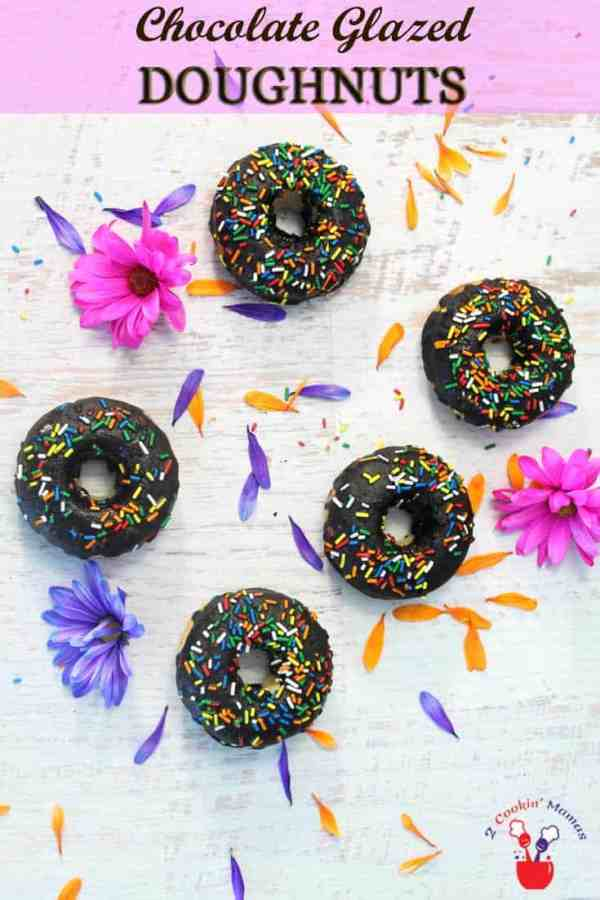 Gluten-free Vanilla Doughnuts with Chocolate Glaze | 2 Cookin Mamas Easy to make baked doughnuts that are moist, flavorful & gluten-free. Glaze with a delicious chocolate glaze & you won't be able to resist licking your fingers. #recipe #glutenfree