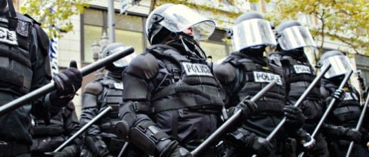 Riot Police Lined Up and Armed