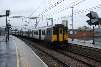 317502 waits at Stratford with a Bishops Stortford service