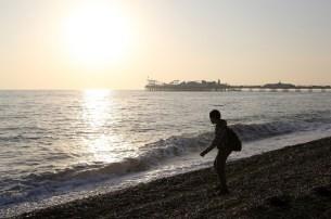 Alasdair Skimming Stones at Brighton