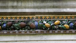 Tile frieze on water fountain at Kew Gardens