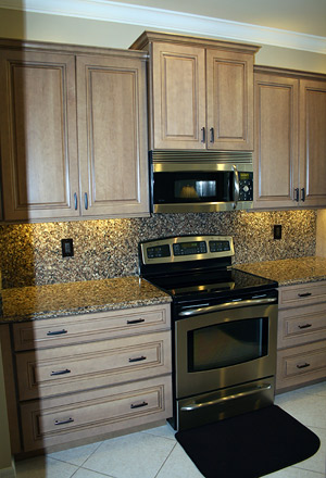 There's often more than just screws holding the kitchen cabinets to the wall. A Kitchen Remodel by Punta Gorda, Florida's Simply Cabinets
