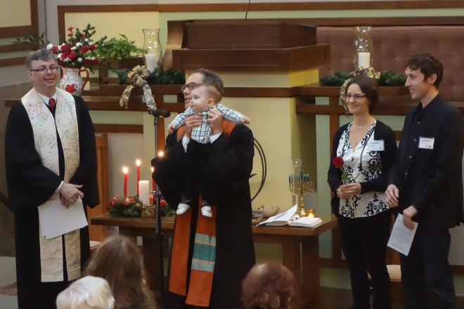 Rev. Alan Taylor presenting Jurgen to the congregation following the dedication. With Associate Pastor Rev. Scott Talbot Lewis, Henriët, and Andrew.