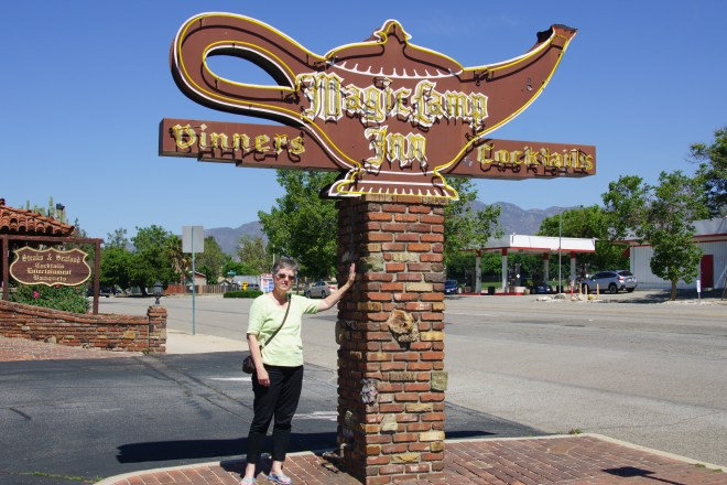 Carla at the Magic Lamp Inn sign in Ranco Cucamonga, California