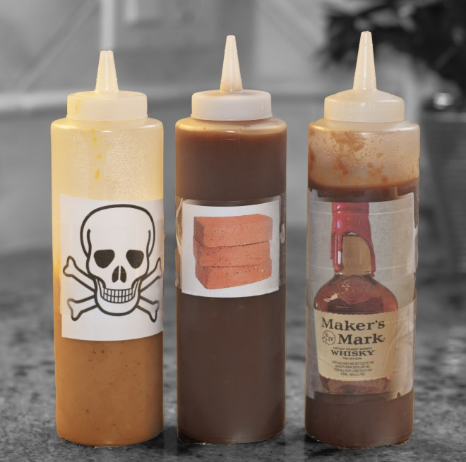 The three barbecue sauces. Mustard vinegar (skull and crossbones) won hands down