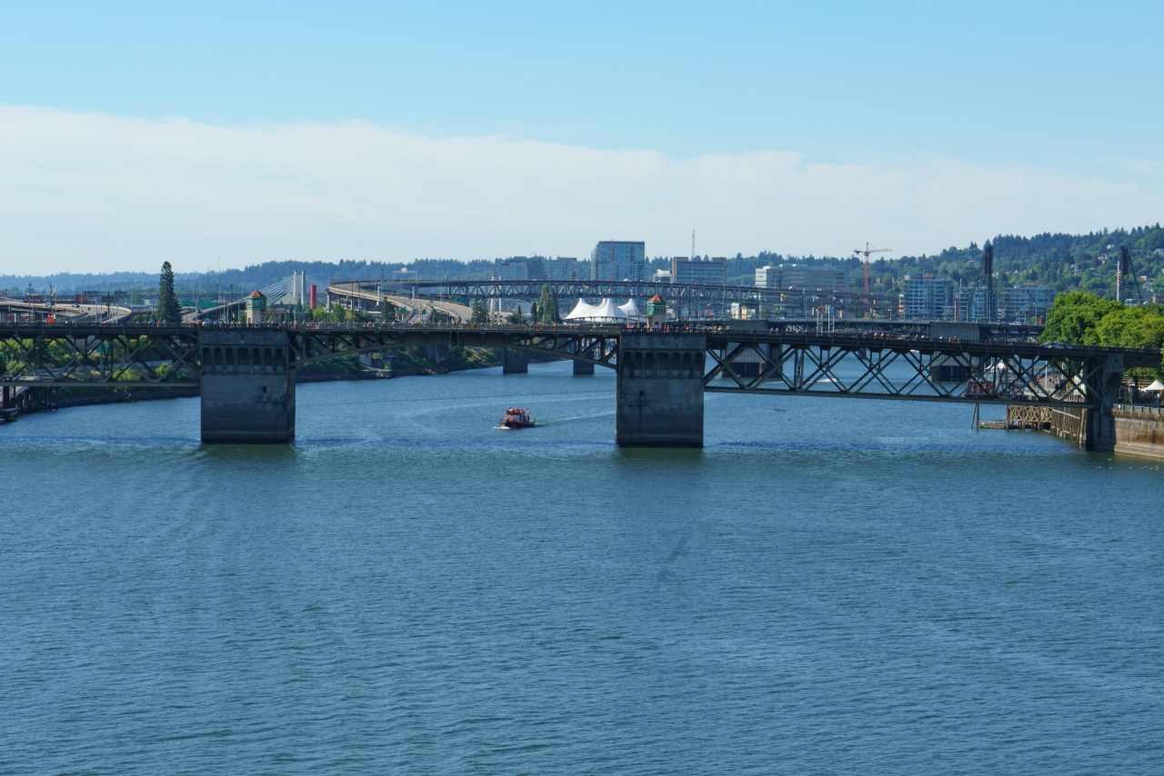 Looking south from the Steel Bridge to the Morrison Bridge. The high bridge in the distance is the other I405 Bridge: the Marquam.