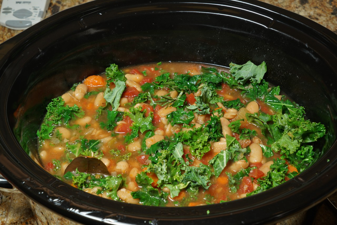 Tomatoes and kale freshly added to the stew