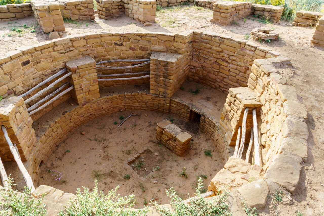 Detail of a Kiva in Mesa Verde. Note the small interior wall to deflect the air around the fire pit in the middle of the floor