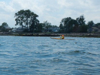 Alex paddling near Larchmont breakwater