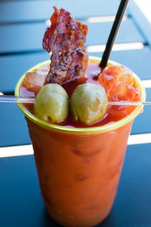 Bloody Mary Cocktail with Candied Caramel Bacon Strip and Blue Cheese-Stuffed Olives