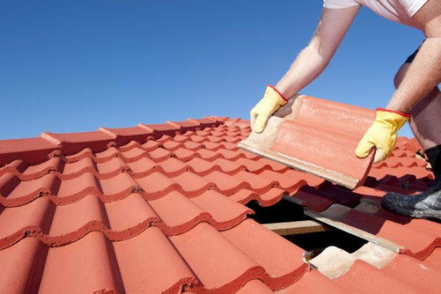roofer laying tiles for a home improvement project