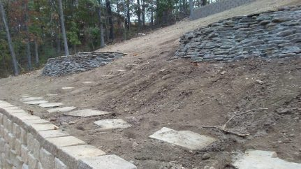 Native Stone Retaining Wall and Pathways