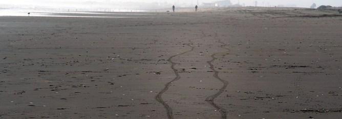 Bicycle tracks on La Serena beach.