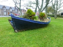 At home old wheelbarrows become gardens on the islands it's old boats.
