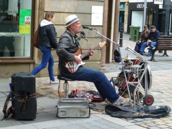 Busker in Academy Street, Inverness.