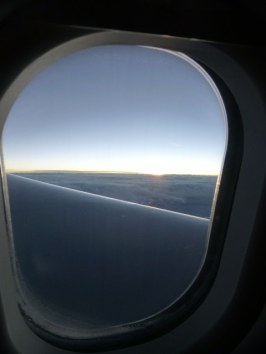 Dawn through the plane window.