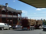 Logging truck pasing in front of the old Royal ? Hotel, Scottsdale.