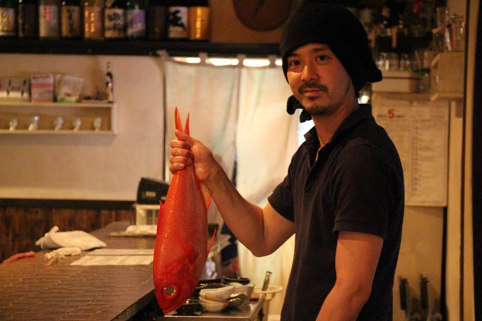 The chef at Ippo presenting a fish