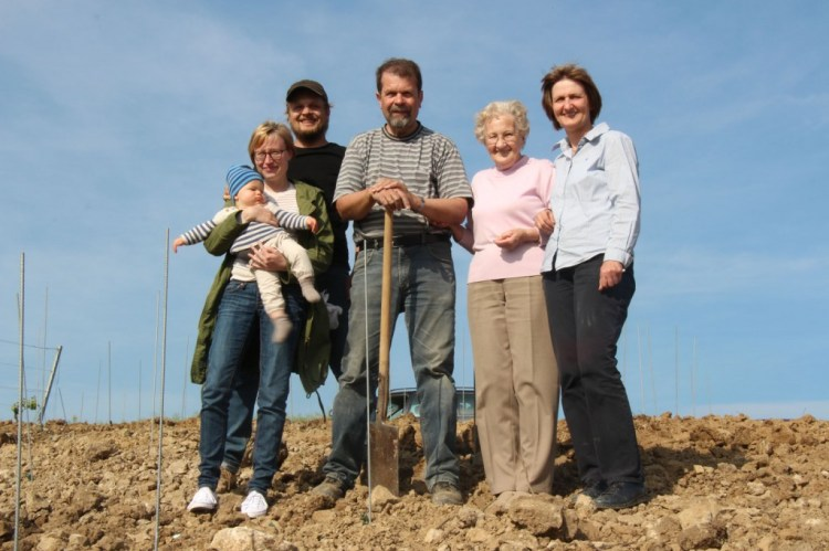 Proud Voelker family in front of a freshly planted Riesling