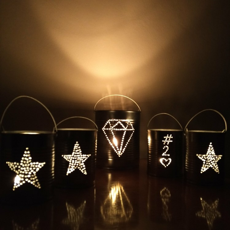 Diamond and stars candle holder lanterns from coffee cans and milk cans, recycled on Curaçao for an experiential tourism program.