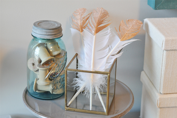 Bird Themed Home Decor White Gold Dipped Feathers with Glitter Jar of Bobbins on Table