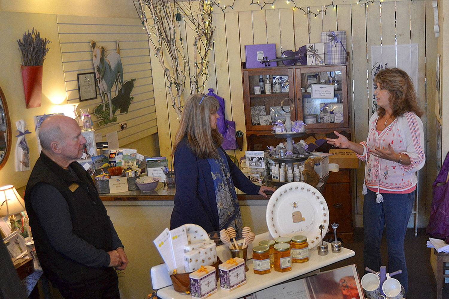 Vickie Oen, general manager of Purple Haze Lavender Shop, speaks to Sequim Mayor Dennis Smith and U.S. Small Business Administration Seattle District Director Kerrie Hurd about the growth of the farm and what led to the start of the shop. Smith and Hurd were part of a walking tour on March 28 to meet-and-greet with small businesses to hear concerns and share possible resources. Sequim Gazette photo by Matthew Nash