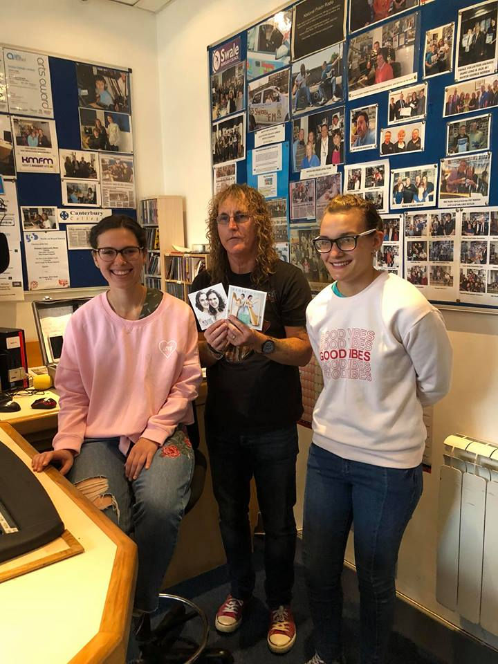 Musicians at Sheppey radio Station with the radio show producer holding their album