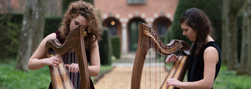 Adel and Karina harpists, playing harps outside at