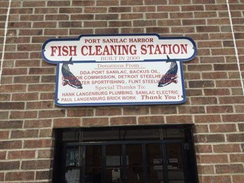 Port Sanilac Harbor Fish Cleaning Station sign.