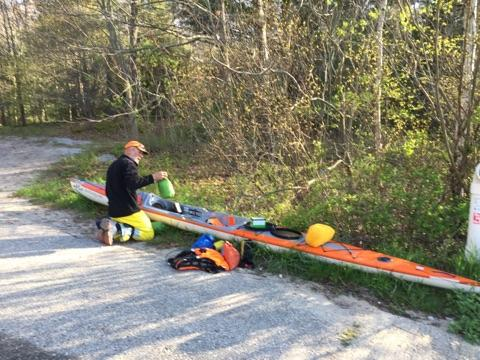 Joe Zellner preparing his orange Stellar Kayak in Duck Lake State Park Michigan.