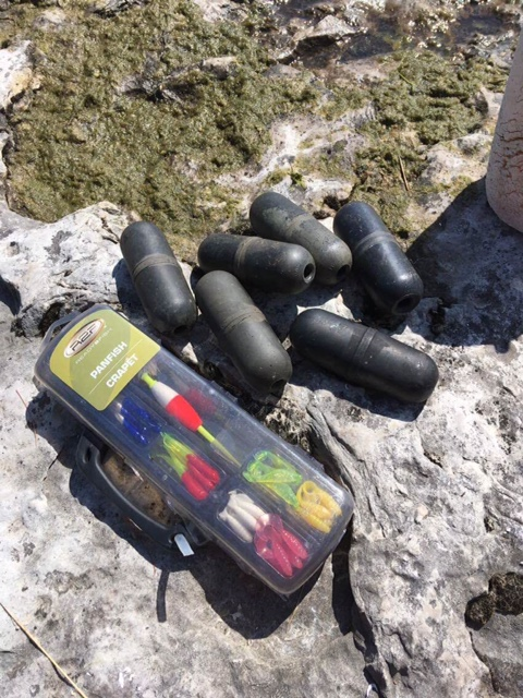 Things Joe finds along the shore. Fish net floats and a brand new, never opened tackle set.