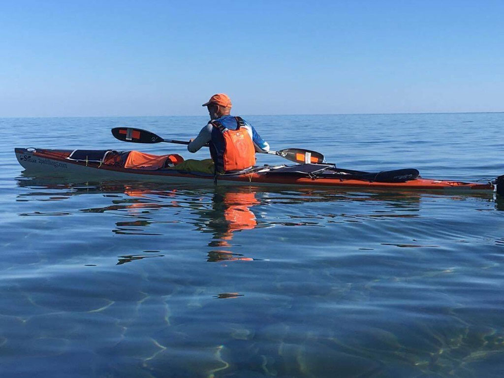 Joe Zellner kayaking on Lake Superior.
