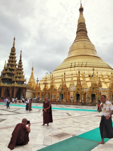 Monks taking smartphone photos.